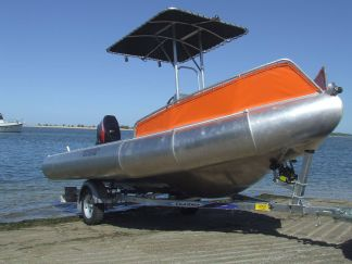 The 5.2 Ocean Craft Chinook.  This hull is rated for 10 people and will transport 2.2 tonnes.