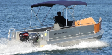 The 6000 Extreme Fisher is a centre console rig with a bimini for weather protection.